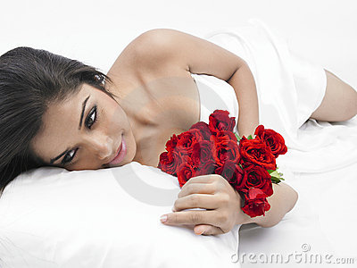 Asian lady in bed with roses