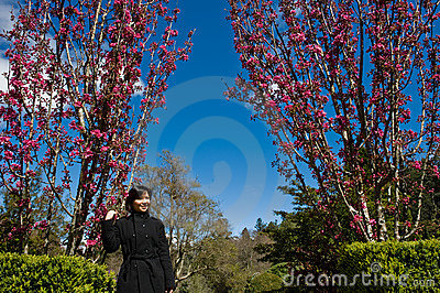 Asian lady in a pink flower garden