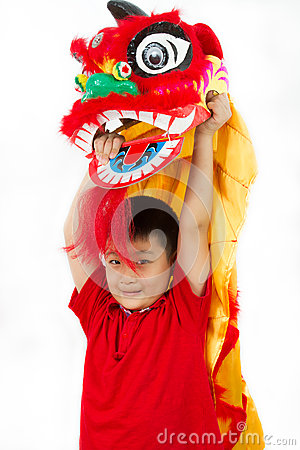 Free Asian Little Boy In Chinese Lion Custome Dance During Chinese Ne Royalty Free Stock Photo - 66689335