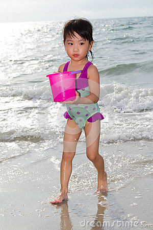 Free Asian Little Chinese Girl Playing With Beach Toys Royalty Free Stock Photo - 67137285