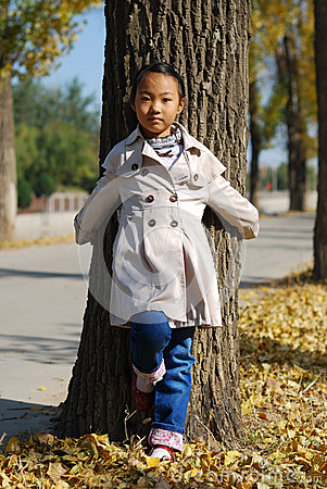 Asian little girl in autumn