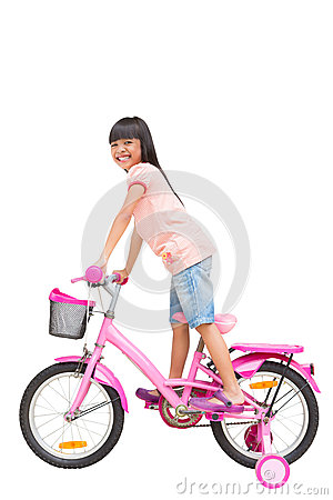 Asian little girl on bicycle