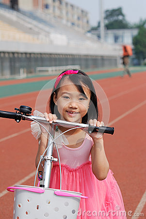 Asian little girl and bicycle