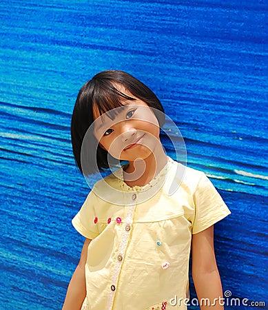 Asian little girl on blue background