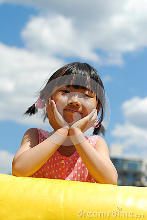 Asian little girl on  the blue sky