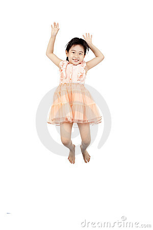 Asian little girl jumping in the air