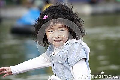 Asian little girl outdoor.