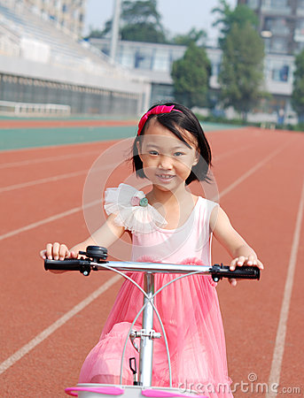 Asian little girl riding a bicycle