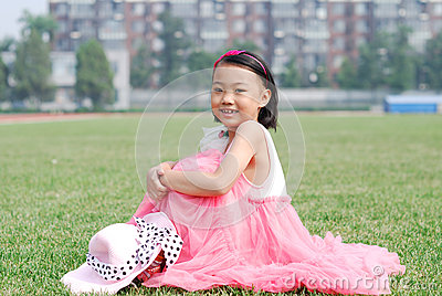 Asian little girl  sitting on the grass