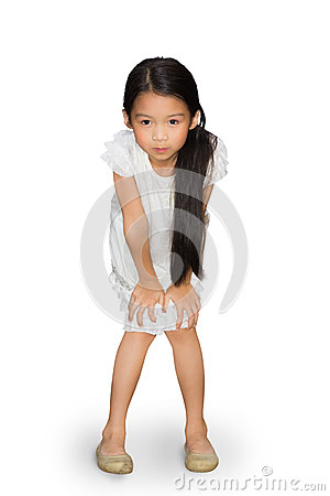 Asian little girl standing with hands on knees