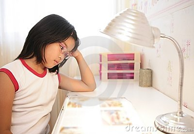 Asian little girl studying at home