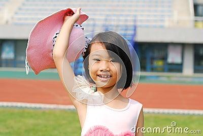 Asian little girl  In summer garden