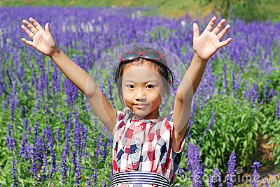Asian little girl  In summer garden