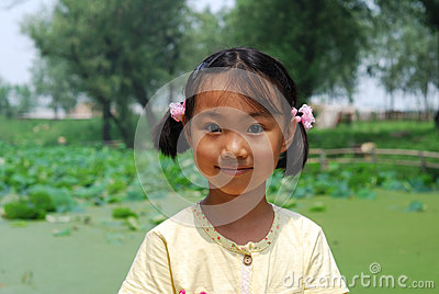 Asian little girl  In summer park