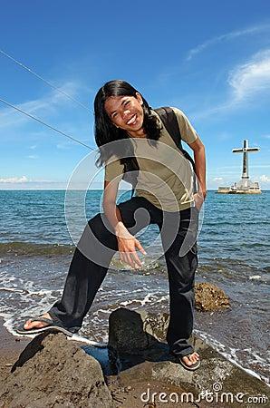 Asian long-haired boy on tropical beach