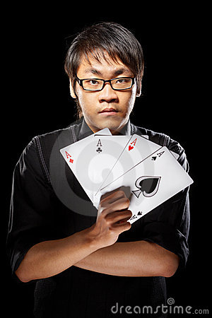 Asian magician with cards