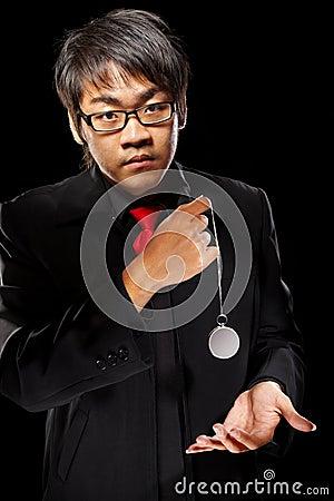 Asian magician with pendulum