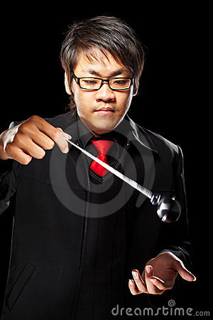 Asian magician with pendulum