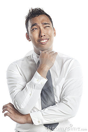 Asian Malay man smiling with a puzzled expression