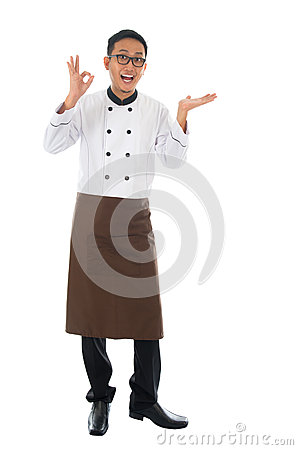 Asian male chef showing copy space and okay hand sign