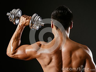 Asian male doing single shoulder press