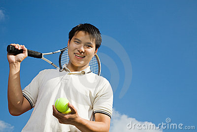 Asian male playing tennis