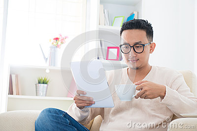 Asian male using computer tablet