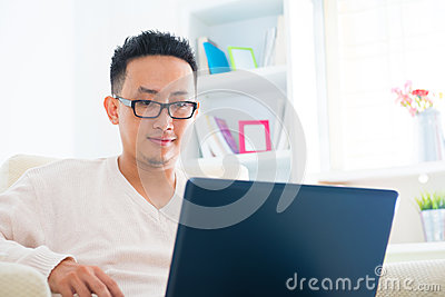 Asian male using notebook