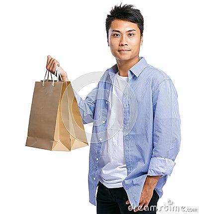 Asian man carry paper bag