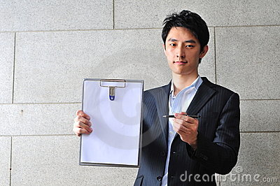 Asian Man with Clipboard asking for signature