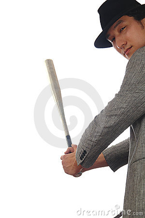 Asian man in hat with baseball