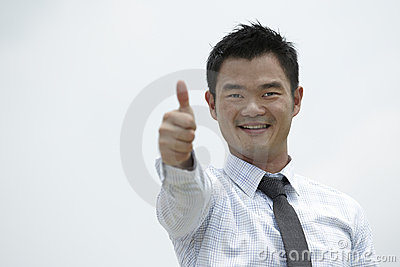 Asian man with his Thumb Up in agreement