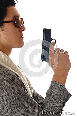 Asian man holding gun