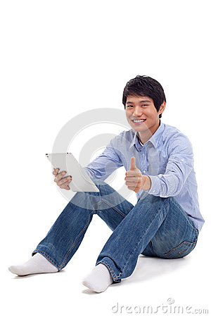 Asian man holding tablet computer isolated