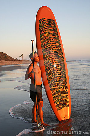 Asian Man with Paddleboard