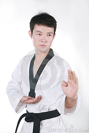Asian man playing  taekwondo
