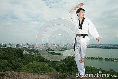 Asian man playing with taekwondo