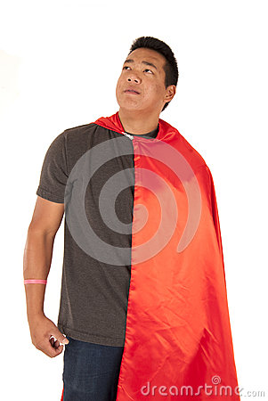 Asian man in red cape looking far away