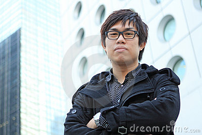 Asian man stand in front of building