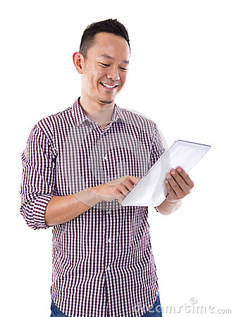 Asian man with tablet computer