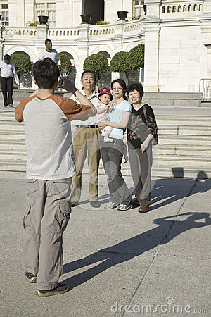 Asian man taking picture of Asian family Editorial Image