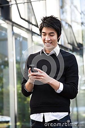 Free Asian Man Texting Stock Image - 6820271