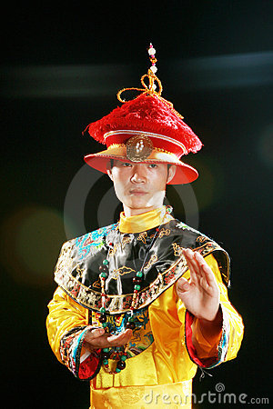 Asian man is wearing a dragon robe