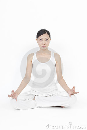 Asian model doing yoga
