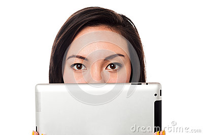 Asian model hiding her face with tablet device