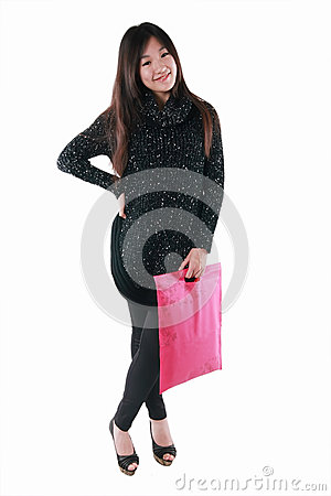 Asian model holding shopping bag