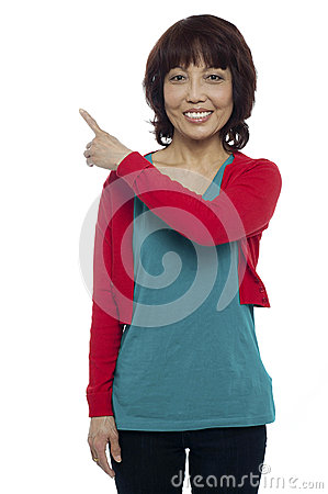 Asian model pointing at the copy space area