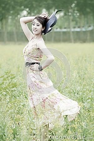 Asian model posing in rape field
