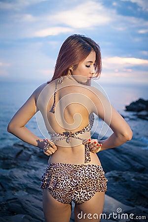 Asian model posing on sunset