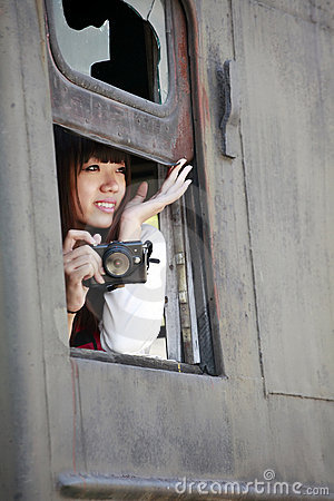 Asian model on train